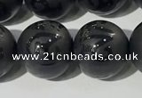 CAA3678 15.5 inches 12mm round matte & carved black agate beads