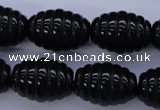 CAG1693 15.5 inches 15*20mm carved rice black agate beads