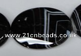 CAG3088 15.5 inches 30*40mm faceted oval black line agate beads