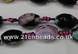 CAG5775 15 inches 10*14mm faceted rice fire crackle agate beads