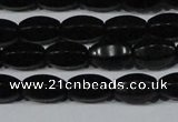 CAG6029 15.5 inches 6*10mm faceted rice matte black agate beads