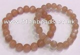 CGB4587 7.5 inches 8mm - 9mm round sunstone beaded bracelets