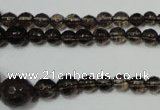 CRO743 15.5 inches 6mm – 14mm faceted round smoky quartz beads
