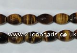 CTE206 15.5 inches 6*8mm faceted rice yellow tiger eye beads
