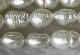 FWP165 14.5 inches 4mm - 5mm rice white freshwater pearl strands
