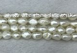 FWP286 15 inches 9mm - 10mm baroque white freshwater pearl strands